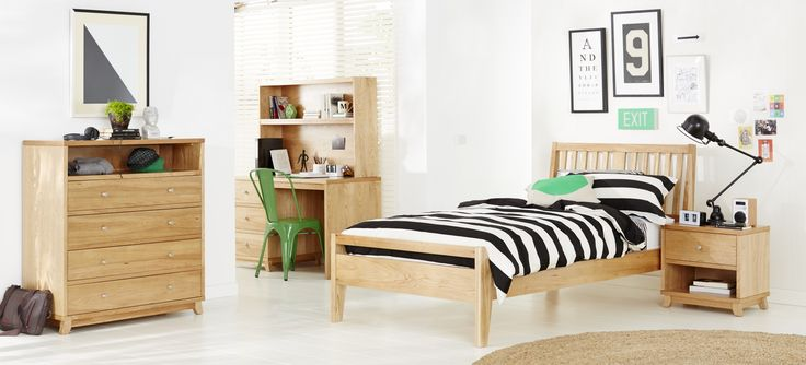 Dakota kids bedroom furniture suite, featuring black and white striped linen and black and white décor accented with green. Available at Forty Winks