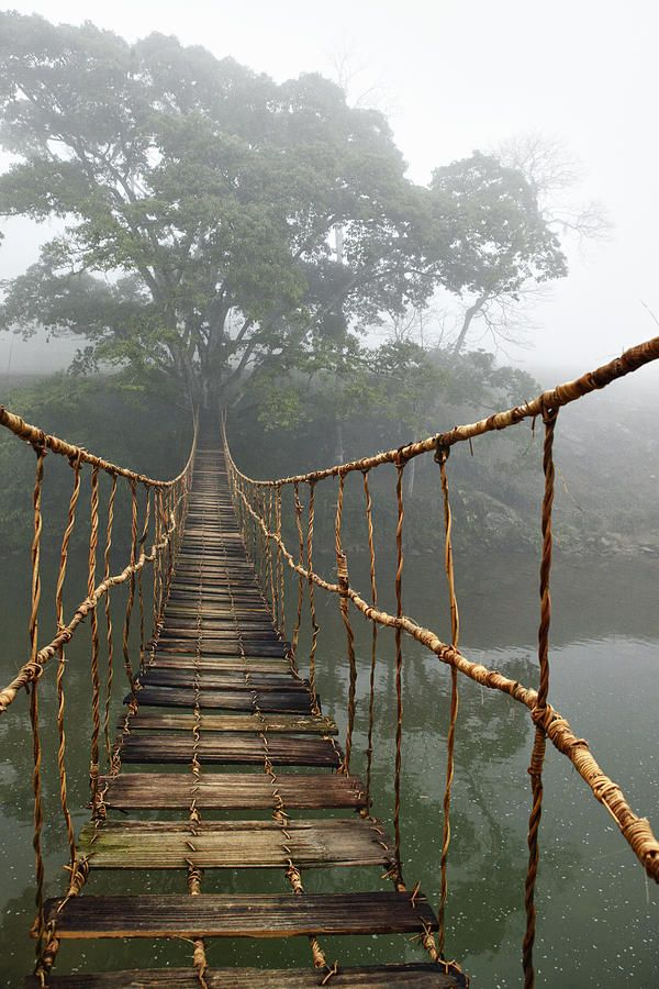 A rope suspension bridge near Sapa, Vietnam is thought to bring good luck to those who cross it.  by Skip Nall