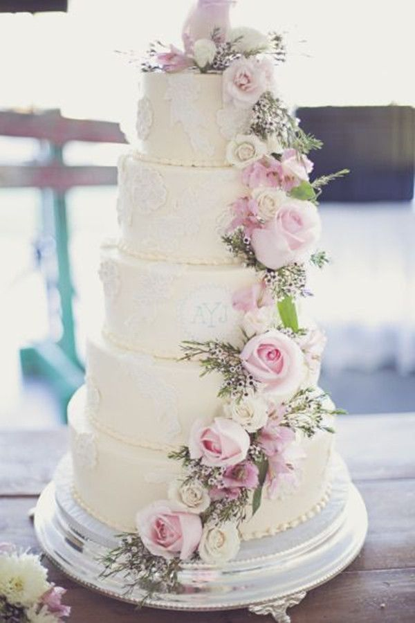 Large tiered wedding cake with floral details