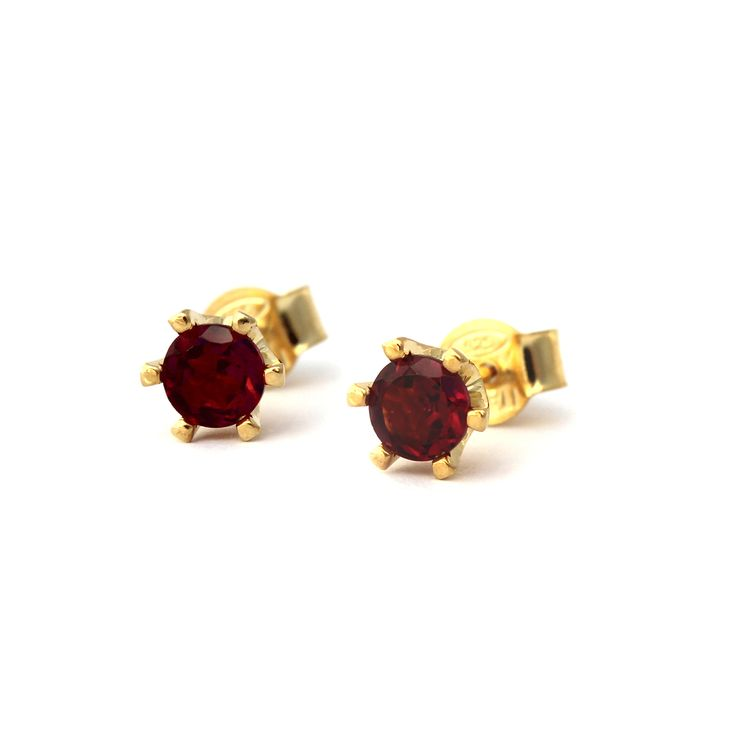 Countess Earrings in 9kt Yellow Gold and Rhodolite Garnet | Handmade from 9 karat yellow gold these beautiful six prong crown style settings feature diamond cut Rhodolite garnet gemstones by Kate McCoy