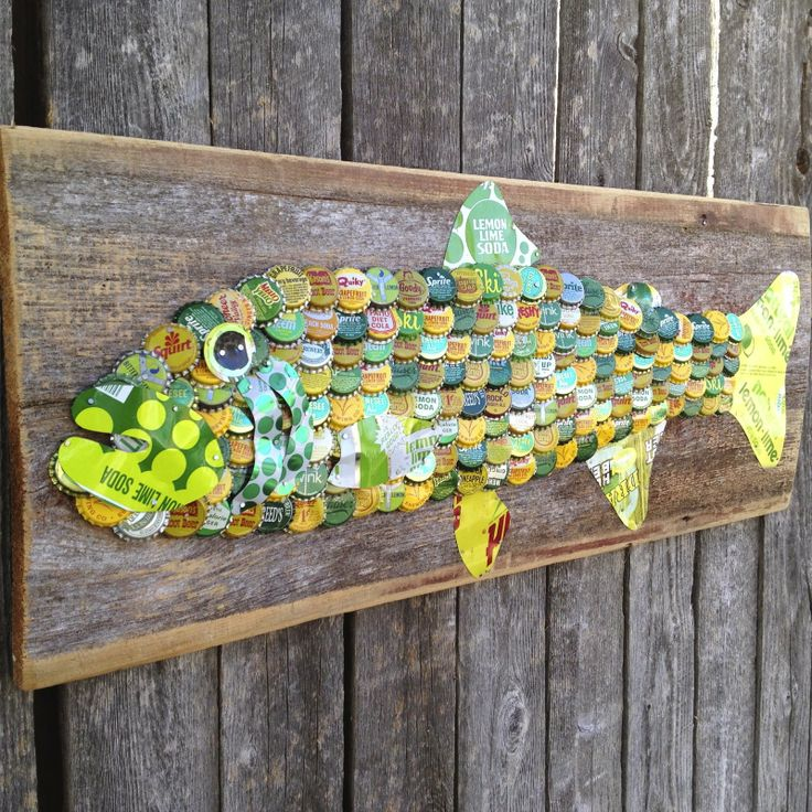 SOLD ART | The Moore Family Folk Art  vintage soda can and bottle cap trout on 90 year old barn wood from Iowa by Emma Moore SOLD
