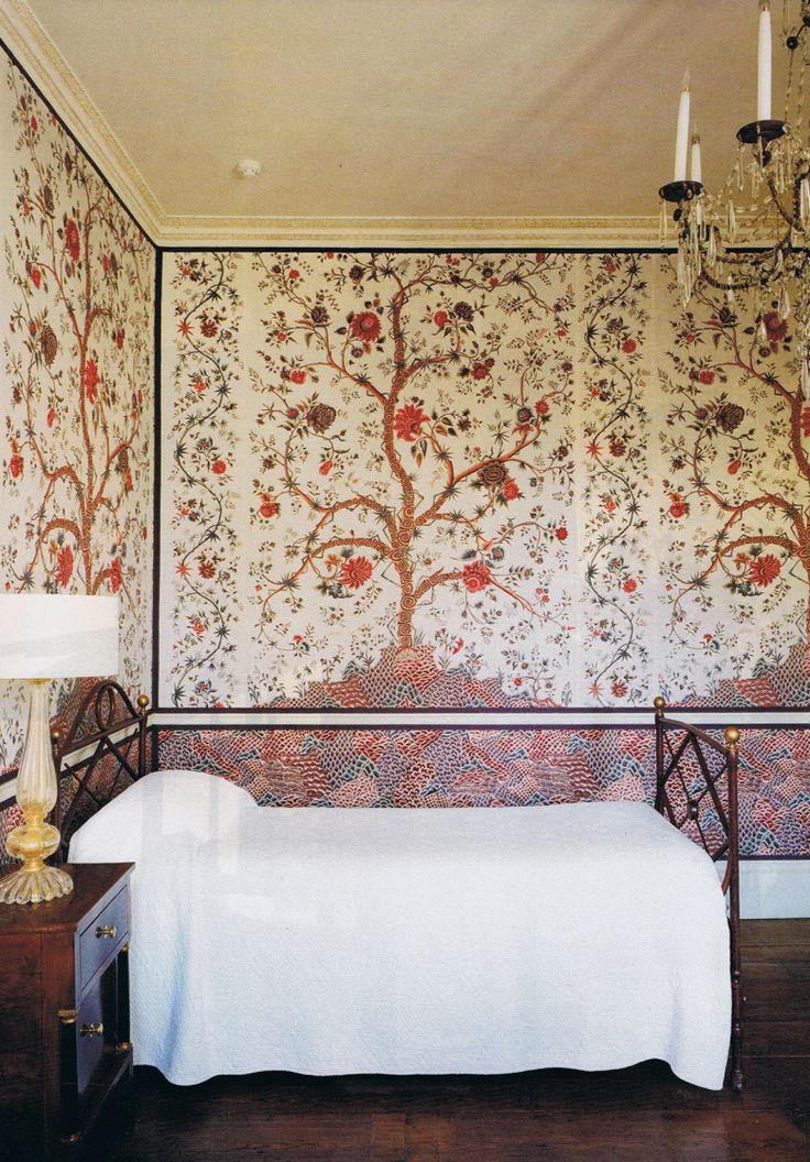 Chintzes from the Tree of Life range by Braquenié for Pierre Frey in a guest bedroom….