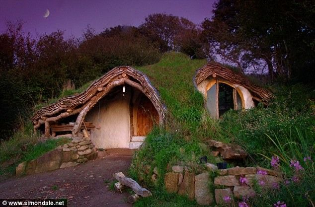 A man in Wales built this home for his family doing the work himself.  It is constructed from wood, stone, straw, and has a sod roof. It's heated with a wood fireplace and has a solar panel for power. Most materials were scavenged.