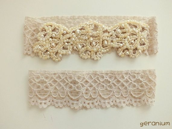 Unique bridal garter set in beige lace.  If you want the best officiant for your Outer Banks, NC, ceremony, contact Rev. Barbara Mulford: myobxofficiant.com/