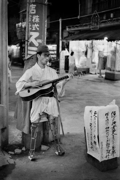 JAPAN. Tokyo. Asakusa district. 1951. A former soldier, wounded during the Second World War, begging in the streets. Many wounded soldiers were forced into poverty after the war, since the government did not allow them any pension. ~ photo by Werner Bischof