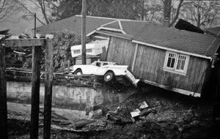 This photograph, taken in Port Alberni, British Columbia, on March 28, 1964, shows the aftermath of the 1964 ALASKA EARTHQUAKE and TSUNAMI. Two of 6 waves that traveled more than 1,800 miles (3,000 km) from the Gulf of Alaska roared up the Alberni Inlet, flipping cars, smashing fifty-eight homes, and damaging 375 others. (Alberni Valley Museum Photograph Collection