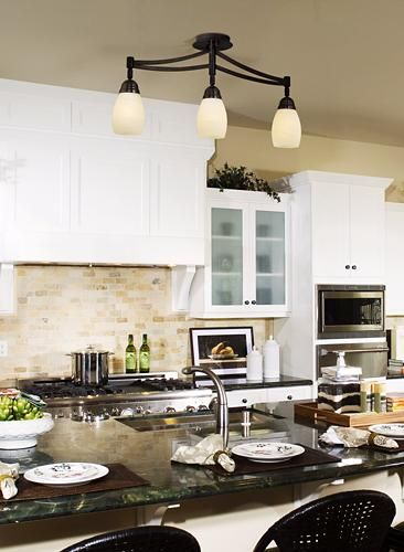 Traditional kitchen decor with transitional track lighting.
