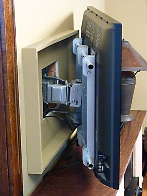 Do you want to mount a flat screen TV on the wall? Here's one way to hide the wires and mounting hardware.