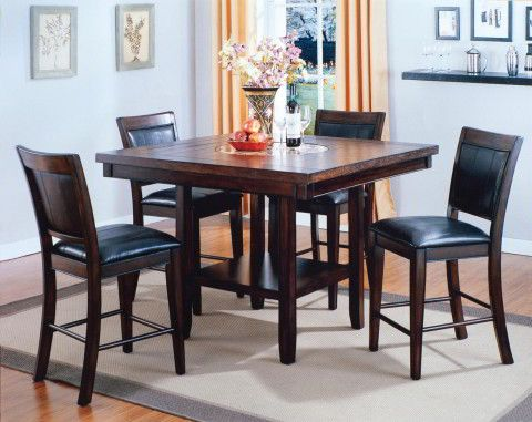 The compact Fulton Dining Set is a great choice for a traditional kitchen nook. This square counter table comes with four traditional dining stools, plus it has a built-in lazy Susan and a storage shelf.