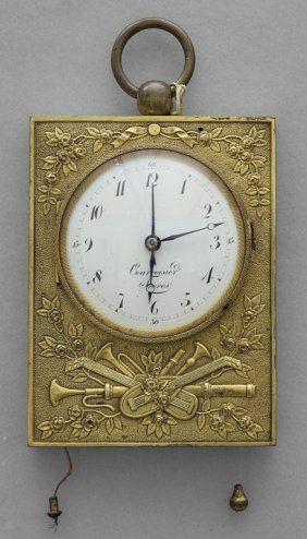 Orologio da carrozza in bronzo dorato con