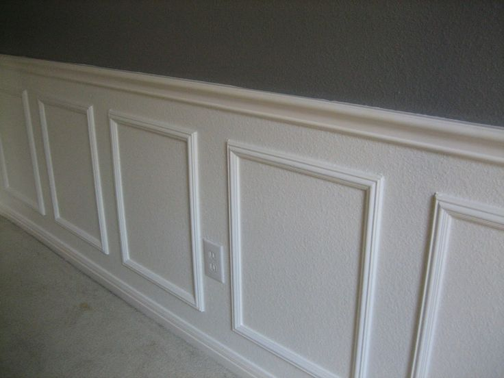 Easy wainscotting idea: buy frames from Michael's, glue to wall and paint over entire lower half.  This would be great