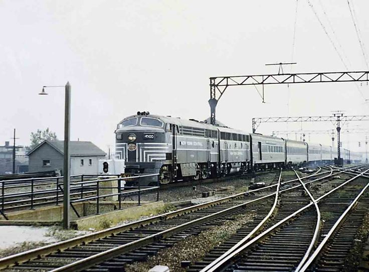 Rare CPA-24-5 4500 (partially hidden by a signal box) and an F3B lead NYC's James Whitcomb Riley north at Illinois Central's 115th Street station; second car is a C&O Newport News–Chicago sleeper.