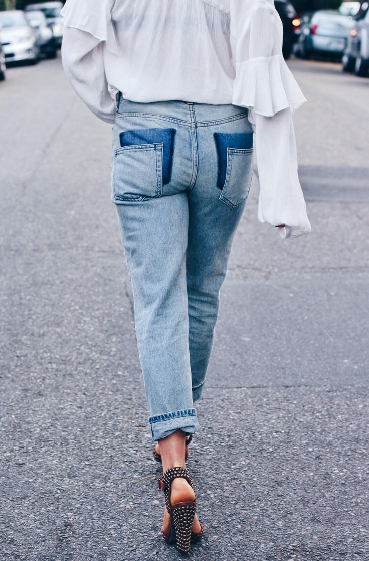 I have an obsession with reworking denim. The addiction has justified my reasoning for never getting rid of jeans, much to my husband's chagrin, no matter how old they are. Really, there's nothing that a pair of scissors can't overhaul. To date, we've patchedholes, fringed cuffs, embroidered