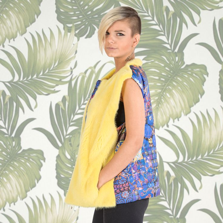 Make the city streets into a runway wearing this weekend-ready yellow mink fur vest.
