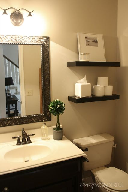 Crazy Wonderful: quick powder room makeover! Floating shelves from Ikea over toilet for storage and decoration, pretty mirror over the sink.