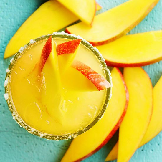 A hint of coconut rum adds tropical flavor to this tasty Mango Margarita. Get 12 more margarita recipes: http://www.bhg.com/recipes/drinks/wine-cocktails/margarita-recipes/?socsrc=bhgpin050313mangomarg=4