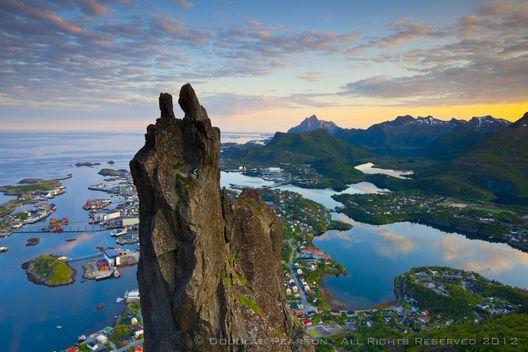 Rock Climers scale the famous Svolvrgeita, Svolvaer, Lofoten, Nordland, Norway