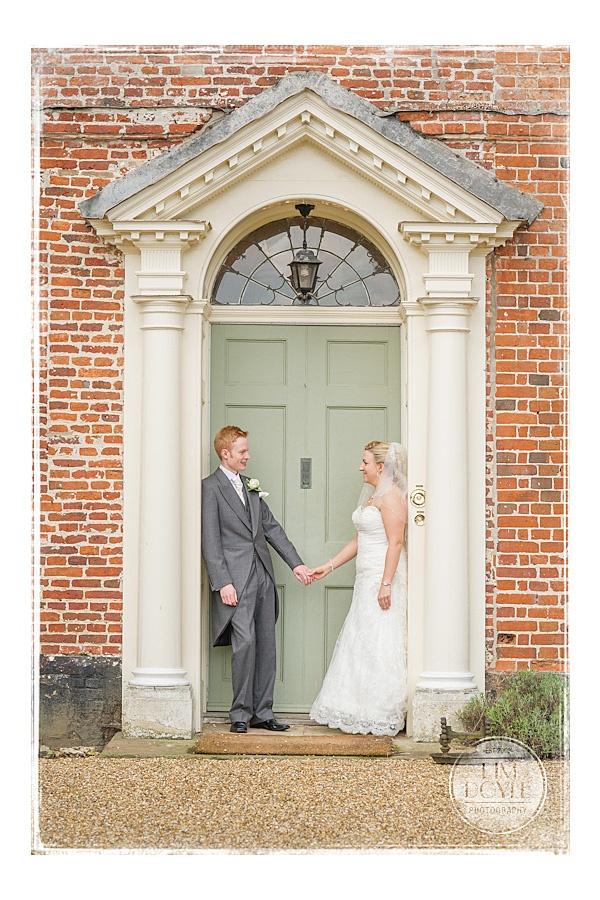 Elms Barn Wedding Venue - Suffolk Wedding Photographer - Tim Doyle Photography - Norwich, Norfolk - Bride and groom in doorway