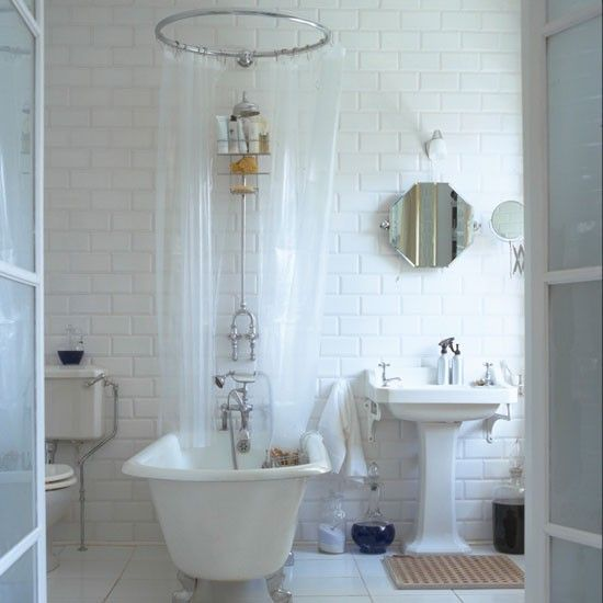 Freestanding and roll-top baths are designed to take centre the stage. If you want to combine with a shower, opt for traditional style fixed head shower and fit a circular rail. This all-white scheme allows the classic shapes to really shine.