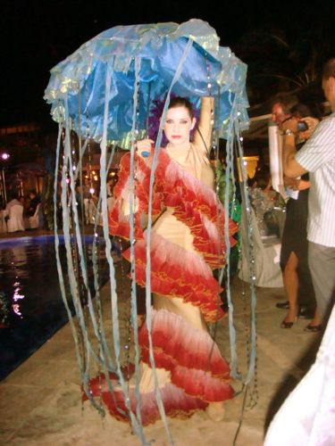 The best jellyfish costume I've found thus far on the internet.  However, I do not want to have to carry an umbrella all night....
