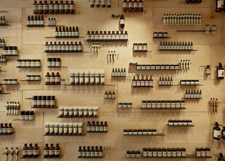 Glass bottles rest on rows of hand-made iron nails along the walls of this Aesop skin and haircare shop in Paris, by French designers Ciguë