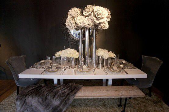 Image from http://s5.weddbook.com/t4/7/9/7/797427/modern-wedding-centerpieces.jpg.