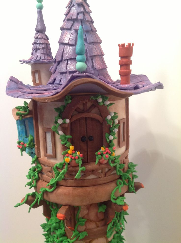 """A Tangled 4th Birthday - Made for my granddaughter's 4th birthday. Lots of prep on this!  The tower is built on PVC pipe, then inserted into a 12"""" cake.  The tower is made of fondant and gumpaste with royal ivy and flowers."""