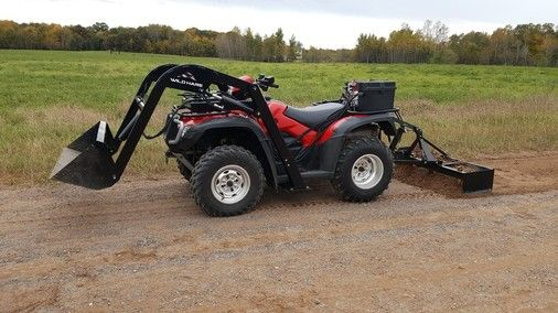 Wildhare hydraulic attachments.  Loader with front and rear 3-point linkage showing leveller and bucket. For more info: http://www.fresh-group.com/atv-quad-bike-hydraulic-attachments.html