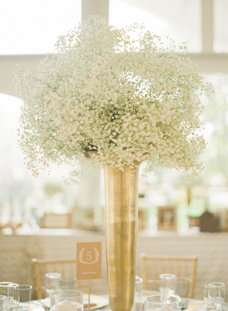 Baby's Breath Tall Centerpiece | Gold Vases | More of the wedding on SMP: http://www.StyleMePretty.com/2014/02/21/crossing-vineyards-winery-wedding/ Lindsay Madden Photography