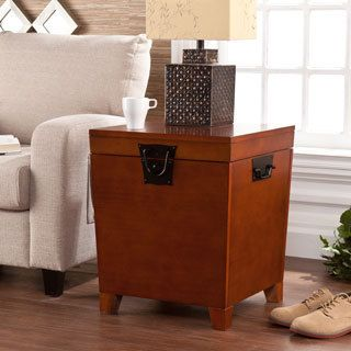This modern storage trunk offers plenty of space inside for storing blankets, photo albums and other small necessities. http://www.overstock.com/Home-Garden/Upton-Home-Nailhead-Espresso-End-Table-Trunk/4130988/product.html?cid=245307