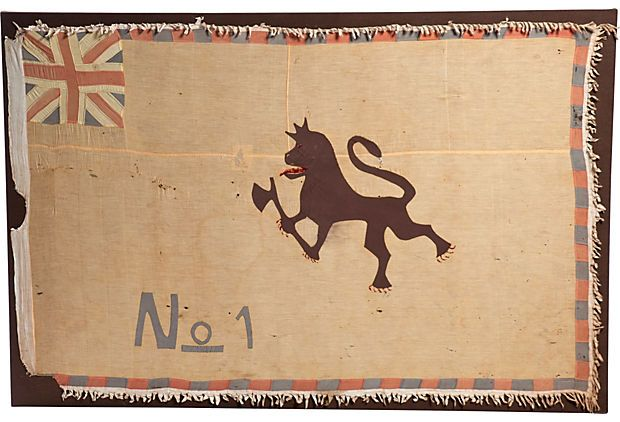 Colonial Asafo Fante flag from Ghana, circa 1940. Large single cotton panel with appliqué lion, Union Jack in upper left and colorful border. Professionally backed, stretched and mounted on pine.