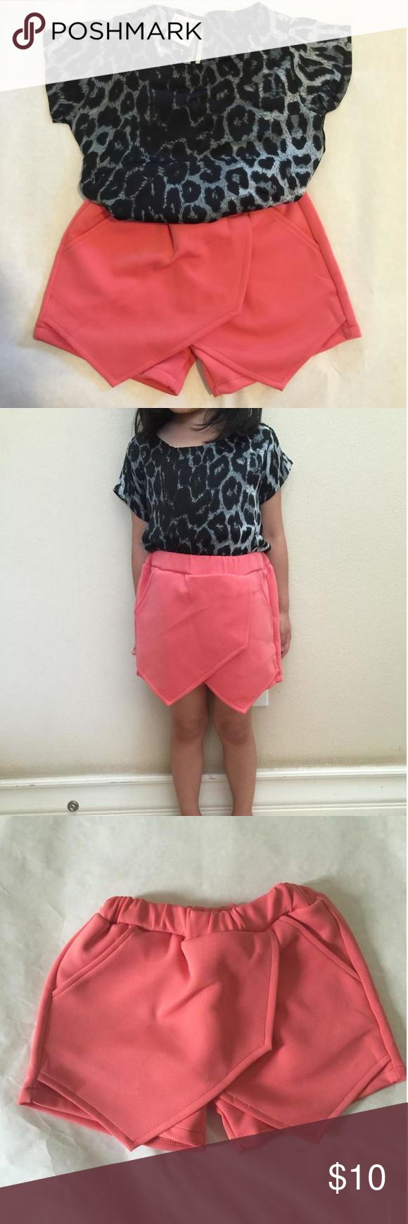 *brand new* Leopard shirt and pink skorts shorts set The latest style princess must have. Two pieces;leopard shirt and pink skorts shorts Matching Sets