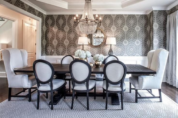 Elegant dining table features an octagon tray ceiling accented with a clear beaded chandelier ...