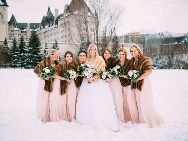 Warm and Fashionable! These blush pink bridesmaids dresses are paired with faux fur stoles for the ultimate winter wedding look | A Romantic Winter Wedding In Ottawa, Ontario | Weddingbells