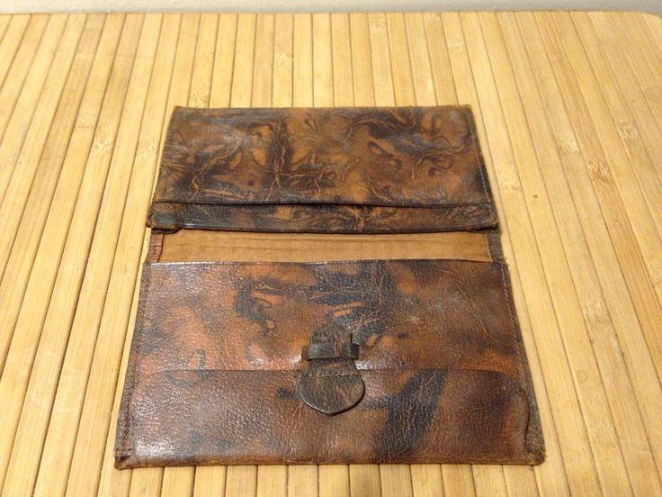 Vintage brown leather wallet with watermark detailing circ pre WW2