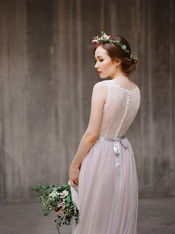 This gown features fitted bodice, a sheer Chantilly lace back and beautiful flowy skirt. The skirt is made using one layer of dusty pink chiffon