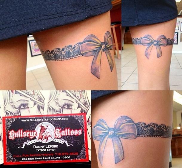 Ribbon thigh tattoo