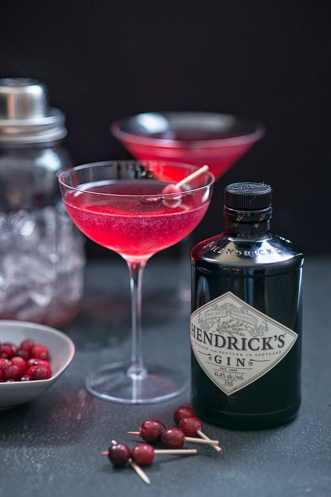 The Red Queen - Cranberry Juice, Gin, St Germain  (Elderflower Liqueur), Lemon Juice, Cranberries Threaded on Cocktail Sticks to Garnish.: