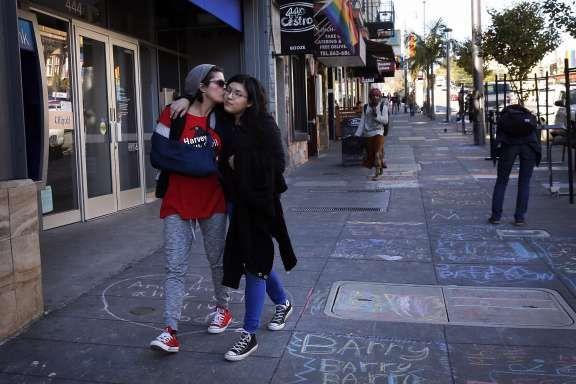 Patti Radigan, 59, kisses her daughter Angelica Tom�, 20, on the cheek after they participated in INSCRIBE, a sidewalk memorial to AIDs victims drawn along Castro street on World AIDs Day Dec. 1, 2016 in San Francisco, Calif. Radigan has been HIV positive for 25 years and has throughout her life been through many difficult times including drug addiction, prostitution and losing her first husband to a heart attack right in front of her. Though her third child was born while Radigan was HIV…