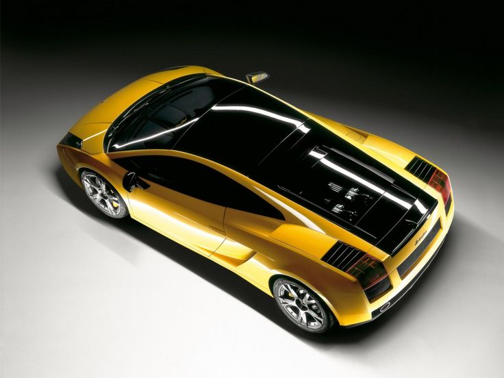 This Angle Clearly Shows The Contrasting Black Painted Parts And The Glass  Engine Cover On The Gallardo SE.
