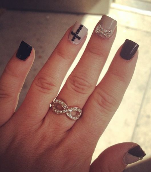 Black and Tan nails with bows and rhinestones