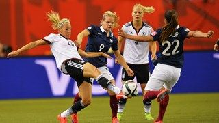Lena Goessling of Germany is challenged by Amel Majri of France