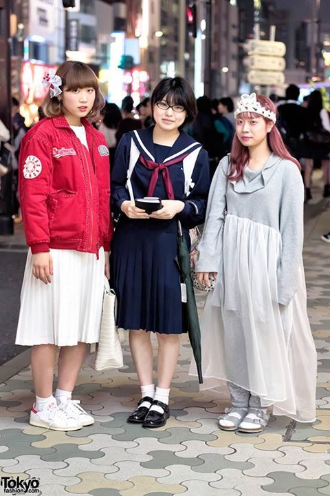 Bunka Fashion College students Na-chan, Oni Gal, and Otowa on the street in Harajuku at night. (Tokyo Fashion, 2015)