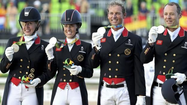 Defending champions Great Britain won silver in the Olympic team dressage, as world champions Germany claimed gold.  The British quartet - Spencer Wilton, Fiona Bigwood, Carl Hester and Charlotte Dujardin - were beaten into second by 3.334 points.  Germany's Sonke Rothenberger, Dorothee Schneider, Kristina Broring-Sprehe and Isabell Werth scored 81.936 points, with Britain on 78.602.  The United States won bronze