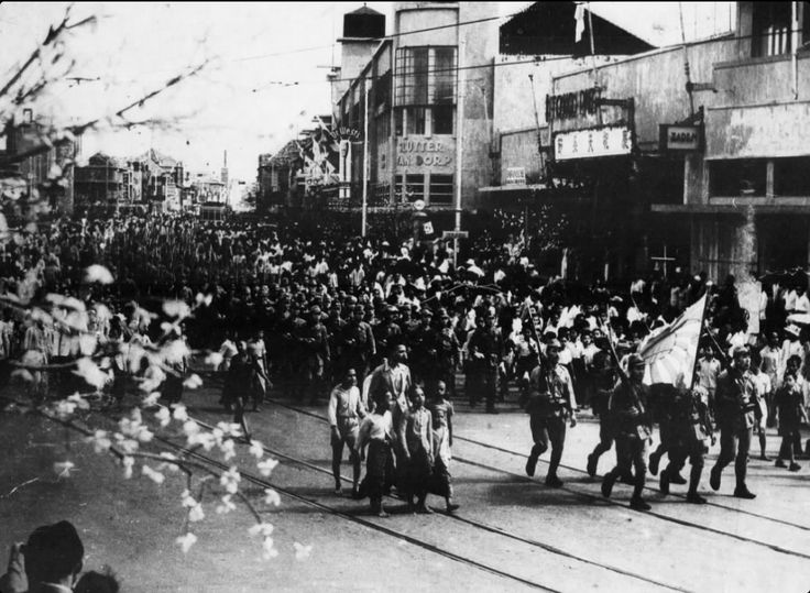 Japanese troops entering Surabaya, Indonesia.