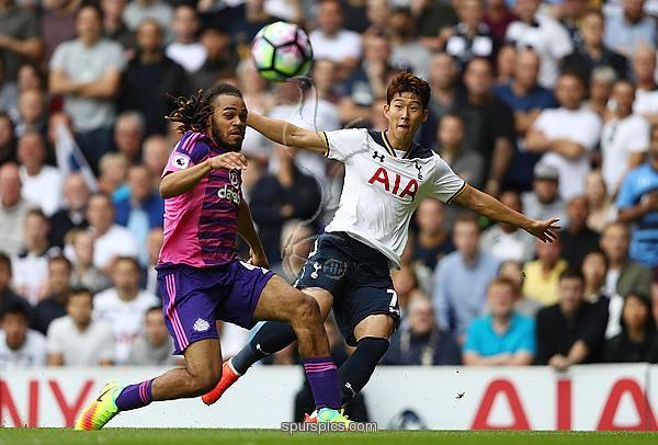 LONDON, ENGLAND - SEPTEMBER 18: Heung-Min Son of Tottenham Hotspur (R) shoots while Jason Denayer of Sunderland (L) attempts a block during the Premier League match between Tottenham Hotspur and Sunderland at White Hart Lane on September 18