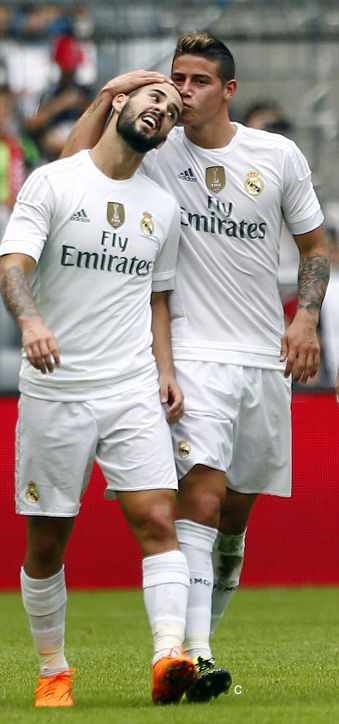 Isco and James celebrate after a goal against levante