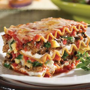 Recipe for Lasagna with Spinach - Filling and satisfying lasagna with sausage, ground beef and three types of cheese.