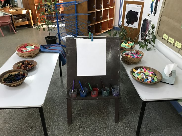 Setting up an art area with choice of materials for the two and three year olds