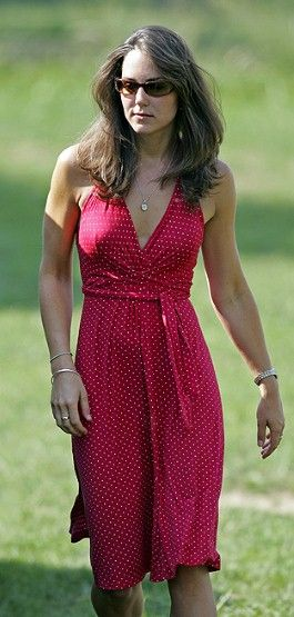 Kate shows off her tiny waistline in this fun, spotty, summer dress at a Polo gathering in sunny Surrey.